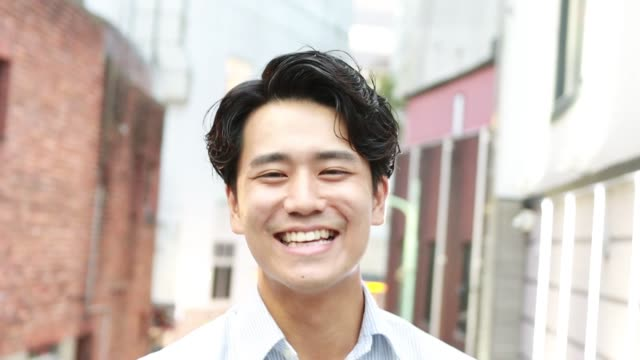 portrait of young asian man is smiling - front view stock videos & royalty-free footage