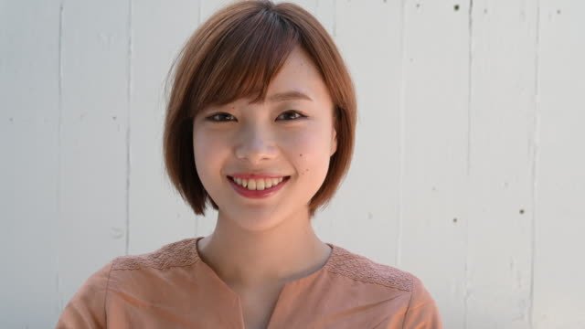 portrait of young asian woman smiling - japanese ethnicity stock videos & royalty-free footage