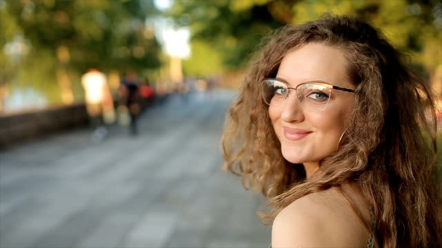 Portrait of young beautiful woman with curly hair