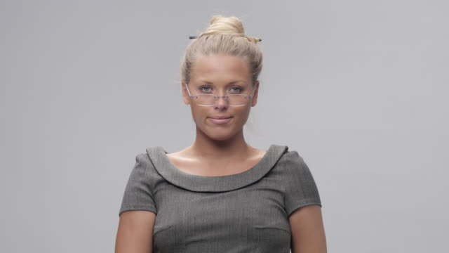 portrait of young, blond, cheerful woman trying new glasses and making faces - green eyes stock videos and b-roll footage