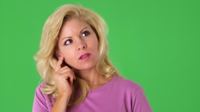 portrait of young blond woman thinking - menschlicher finger stock-videos und b-roll-filmmaterial