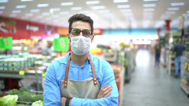 portrait of young business man owner with face mask at supermarket - protective workwear stock videos & royalty-free footage