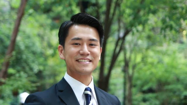 アジアの若いビジネスマンの肖像 - ハンサム点の映像素材/bロール