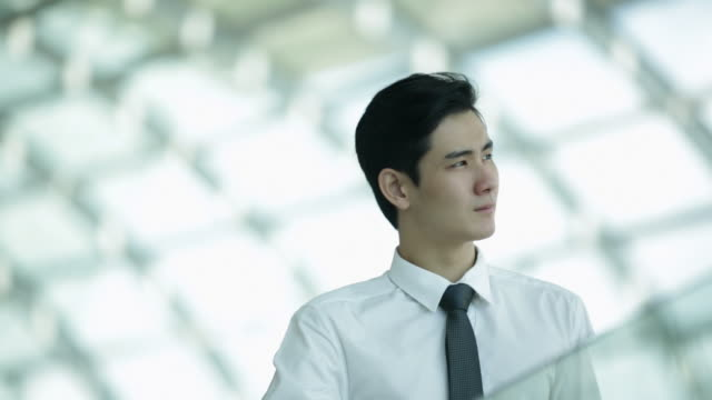 CU Portrait of young businessman in office.