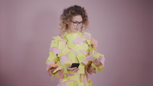 portrait of young businesswoman covered in sticky notes. - trapped stock videos & royalty-free footage