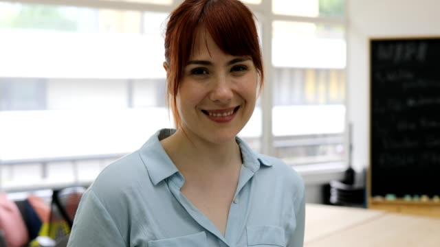 portrait of young businesswoman smiling in office - bangs stock videos & royalty-free footage