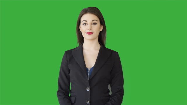 portrait of young caucasian business women isolated on green screen background