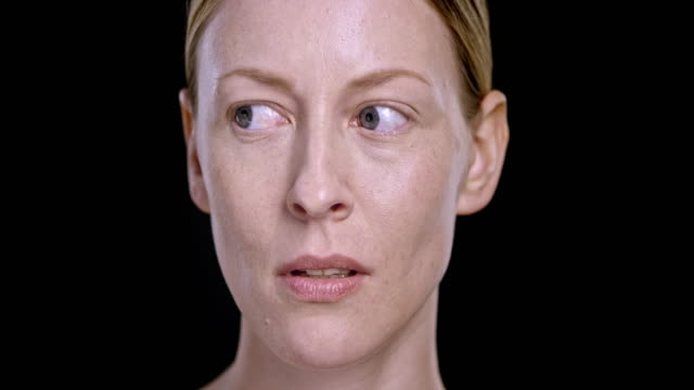 portrait of young caucasian woman moving her eyes around - fear stock videos & royalty-free footage