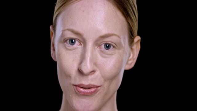 Portrait of young Caucasian woman talking