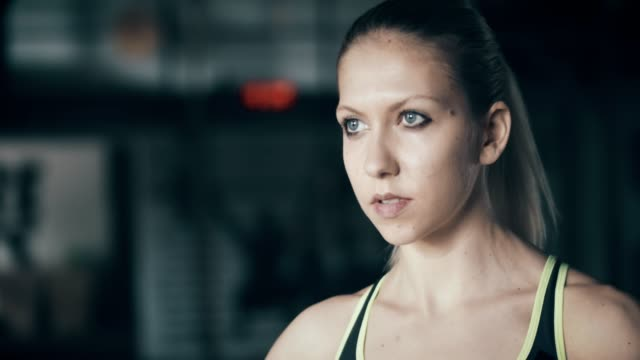 Portrait of young confident woman in gym