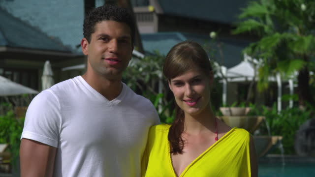 cu portrait of young couple in hotel resort in tropical surroundings, krabi, thailand - see other clips from this shoot 1459 stock videos and b-roll footage
