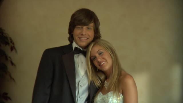 cu, portrait of young couple in prom attire, edison, new jersey, usa - coppia di adolescenti video stock e b–roll