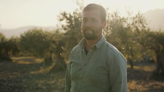 vídeos y material grabado en eventos de stock de portrait of young farmer among olive trees - dedicación