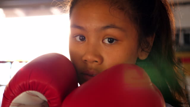 cu portrait of young female boxer in ring during training session - determination stock videos & royalty-free footage