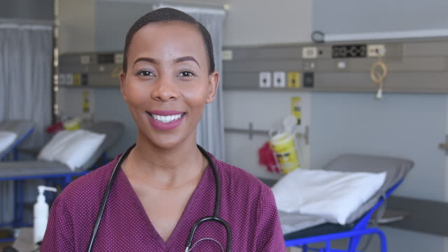 portrait of young female doctor on hospital ward - female nurse stock videos and b-roll footage