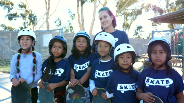 ms portrait of young female friends and female instructor at skateboarding camp - summer camp stock videos & royalty-free footage