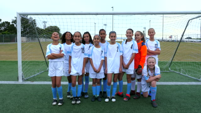 ms portrait of young female soccer team standing together in front of goal - football pitch stock videos & royalty-free footage