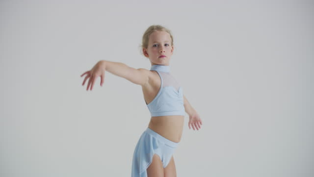 portrait of young girl ballet dancer practicing, and warming up in studio - one girl only stock videos & royalty-free footage