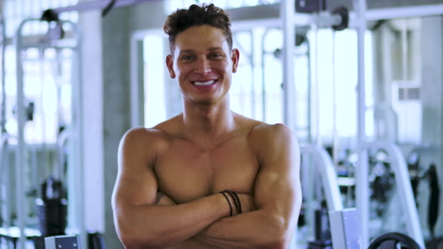 portrait of young handsome man at gym club - body building stock videos & royalty-free footage