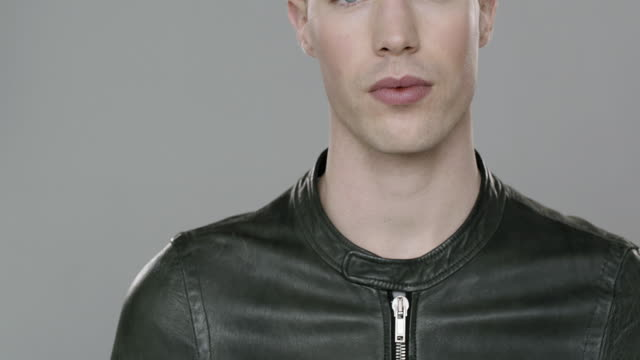 portrait of young handsome man looking at camera - leather jacket stock videos & royalty-free footage