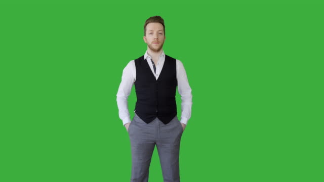 stockvideo's en b-roll-footage met portrait of young handsome white man isolated on green screen background. - overhemd