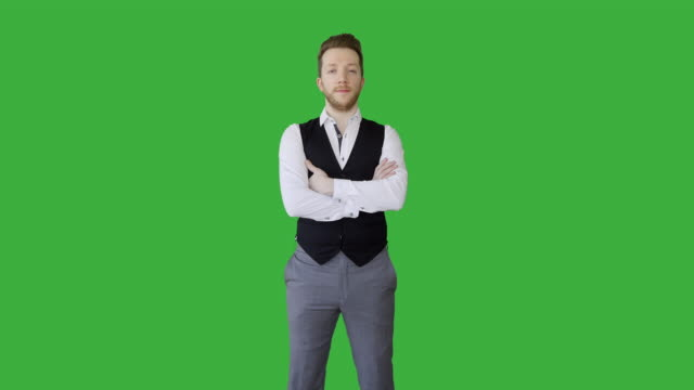 portrait of young handsome white man wearing casual clothes standing isolated on green screen background.