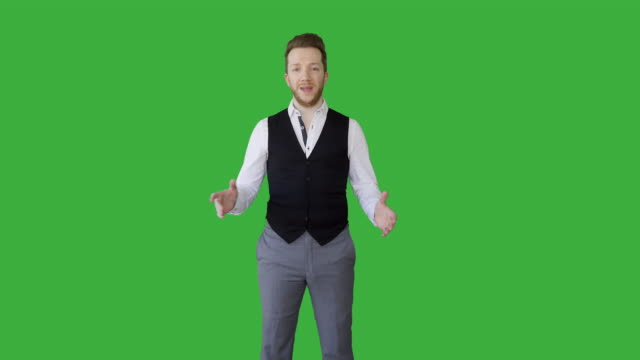 vidéos et rushes de portrait of young handsome white man wearing casual clothes talking about business idea standing isolated on green screen background. - expertise