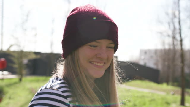 portrait of young hipster women wearing a hat smiling to camera - real people stock videos & royalty-free footage