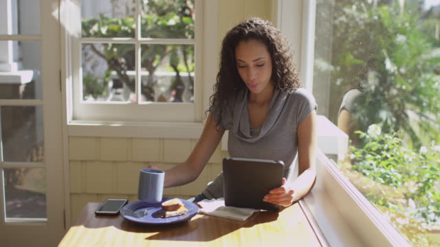 portrait of young hispanic woman having breakfast - indoors stock videos & royalty-free footage
