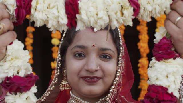 portrait of young indian bride in traditional wedding dress costume - 民族衣装点の映像素材/bロール
