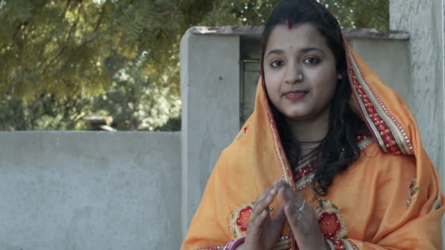 portrait of young indian woman in traditional dress costume in her domestic lifestyle - indigenous culture stock videos & royalty-free footage