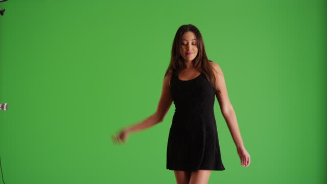portrait of young latina female in short black dress dancing on green screen - black dress stock videos & royalty-free footage