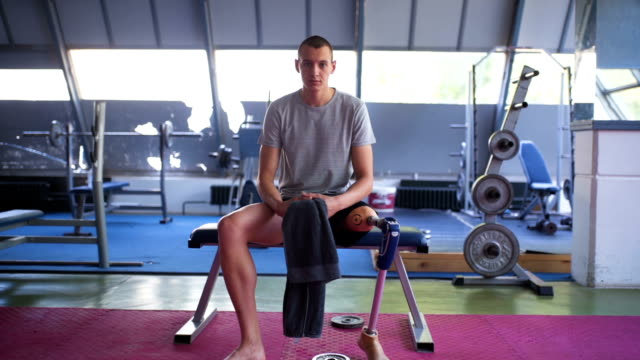 portrait of young leg amputee man - adaptive athlete stock videos and b-roll footage