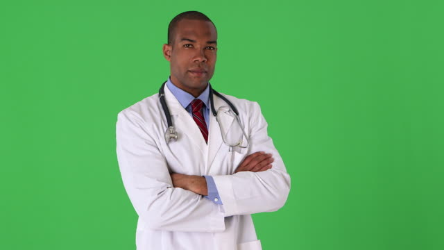 portrait of young male doctor - waist up stock videos & royalty-free footage