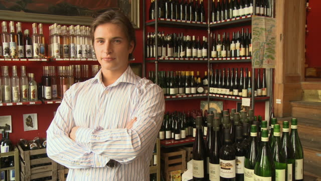 MS, Portrait of young man in wine shop, Berlin, Germany