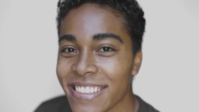 portrait of young man smiling on white background - schöne menschen stock-videos und b-roll-filmmaterial