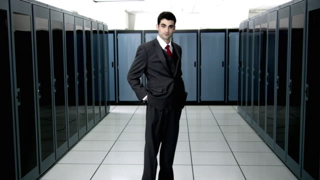 WS DS CU Portrait of young man standing in server room