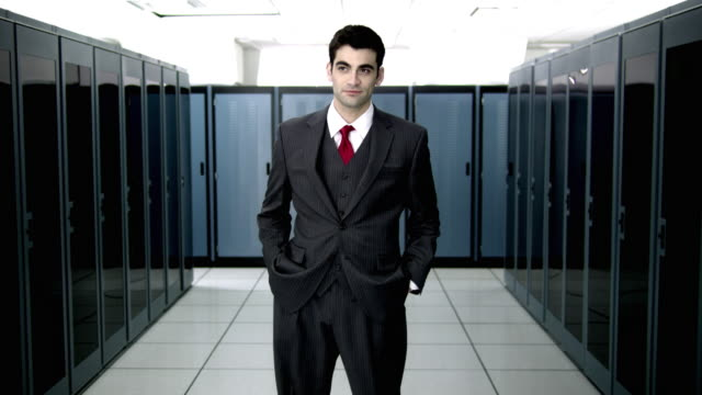 ms ds ws portrait of young man standing in server room - wide shot stock videos & royalty-free footage