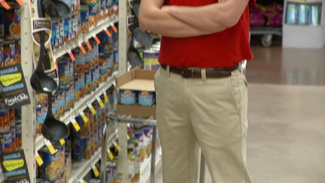 MS TU Portrait of young man standing in supermarket aisle, Richmond,  Virginia, USA
