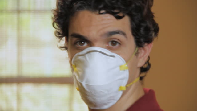 cu portrait of young man wearing protection mask / madison, florida, usa - allergy stock videos & royalty-free footage