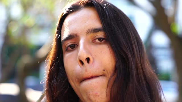 portrait of young man with long hair - ugliness stock videos & royalty-free footage