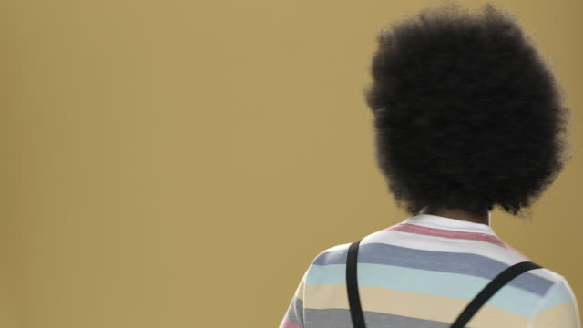 portrait of young man with styled big hair - big hair stock videos & royalty-free footage