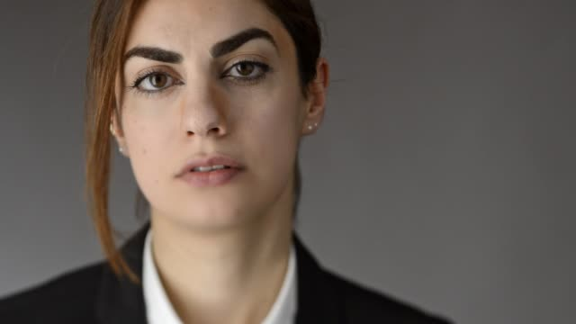 portrait of young modern arab woman. - gray background stock videos and b-roll footage