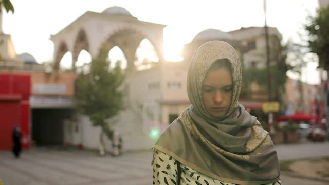 portrait of young muslim woman in urban environment near a mosque - headscarf stock videos & royalty-free footage