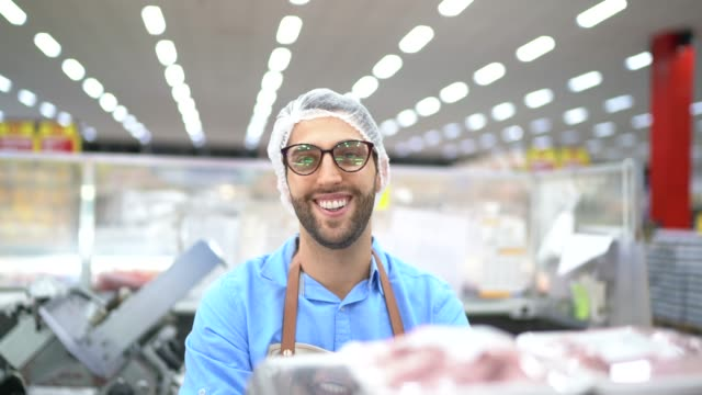 portrait of young owner / employee at supermarket - employee stock videos & royalty-free footage