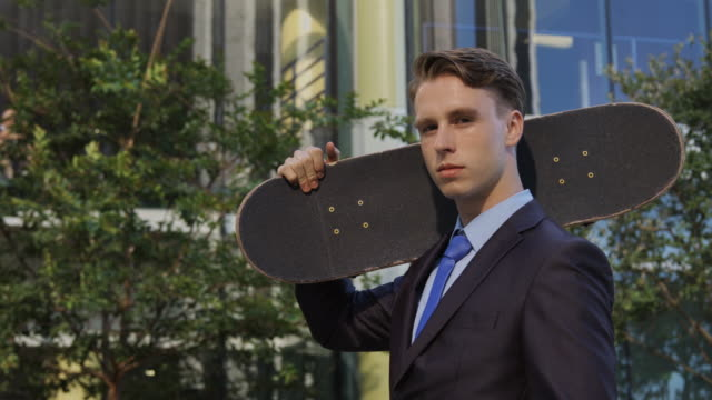 Portrait of Young Professional with Skateboard