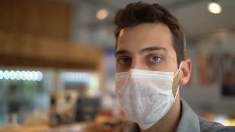 portrait of young small business man owner with face mask - shop stock videos & royalty-free footage