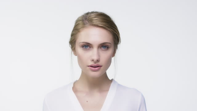 portrait of young woman against white background - fashion model stock videos and b-roll footage