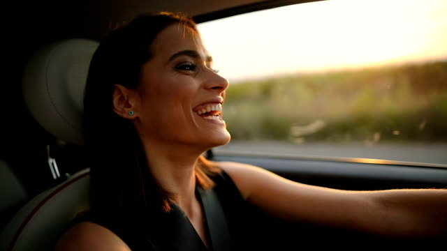 portrait of young woman driving car - joy stock videos & royalty-free footage