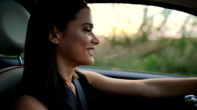 portrait of young woman driving car - car interior stock videos & royalty-free footage